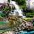 Scenic Waterfall cascading down in garden