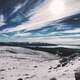 Snow covered Mountaintop Landscape and sky