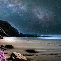 Stars in the night sky on the beach