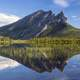 Sukakpak Mountain and reflective Lake in Alaska