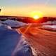 Sunset on a snowy day and path