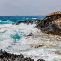 Waves Crashing on the Rocky Shoreline