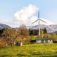 Wind Farm under the Mountains with meadow