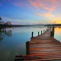 Wooden walkway into the lake sunset