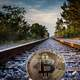 Bitcoin on railway tracks