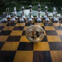 Bitcoin standing on a chess board