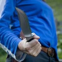 Camping Knife with person in blue shirt
