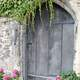 Door with flowers around it
