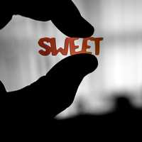 Fingers Holding Sweet Word