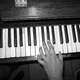 Hand playing keyboard keys