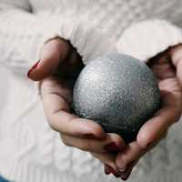 Hands holding a Christmas Ornament Ball