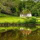 House by the pond in greenery