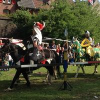 Knight riding on horse at medieval festival