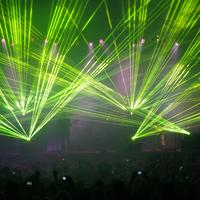 Laser light show of green during a concert