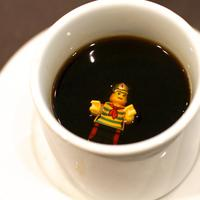 Legoman drowning in a cup of coffee