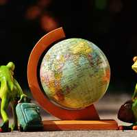 Miniature Globe with two frogs