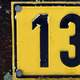 Number 13 on a road sign thirteen