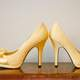Pair of Golden Shoes with high heels