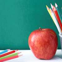 Primary school pencils and apple