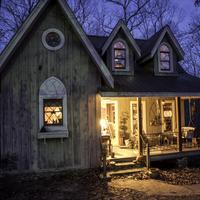 Small Cottage in the Woods with Porch light