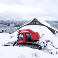 Snow covered Roof with tractor