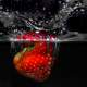 Strawberry Plunging into Water