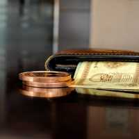 Wallet with paper bill and coin