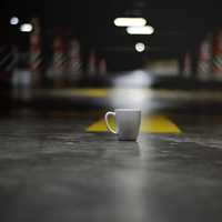 White Ceramic Coffee Cup on the ground