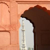 Minar-e-Pakistan richly framed by an aisle arch in Lahore