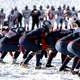 american-football-team-playing-in-the-snow