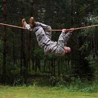 AFENWOEHR, Germany - Spc. Leroy Suquitana, a USARUER HHBN Soldier working as a reception cell clerk, negotiates the rope-bridge obstacle 20 Aug. during the 2013 Best Warrior Competition's obstacle course here. The U.S. Army Europe Best Warrior Competition is a weeklong event that tests Soldiers' physical stamina, leadership and technical knowledge and skill.  Winners in the Soldier and Noncommissioned Officer categories of the USAREUR competition will go on to compete at the Department of the Army level. (U.S. Army photo by Spc. Joshua Leonard)