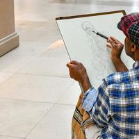 Artist doing a sketch on a Canvas