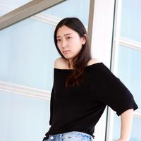 Asian Girl in black shirt and jeans