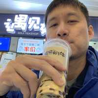 Asian guy drinking Bubble Tea