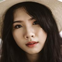 Asian pretty girl face in a hate with long hair