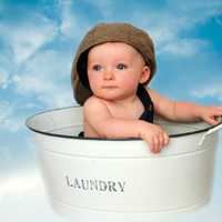 Baby in a laundry bucket