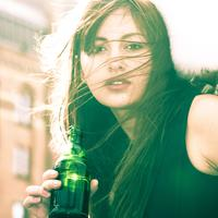 Beautiful Woman with wind-swept hair with a drink