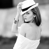 Beautiful young Back in white backless shirt and hat