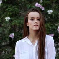 Beautiful Young Woman in white shirt with long hair