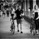 black-and-white-of-two-people-walking-their-bikes
