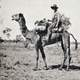 black-and-white-photo-of-michael-terry-riding-a-camel