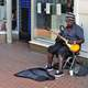 Black man playing Guitar on the street