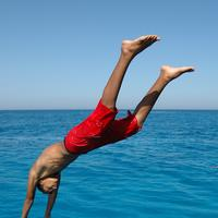 Boy Diving into the Water