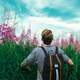 boy-hiking-through-the-tall-grass