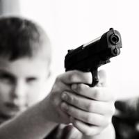 Boy Pointing a Gun