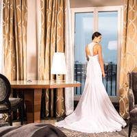 Bride in White Dress in Hotel Room
