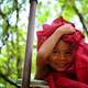 child-with-red-textile-covering