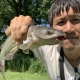 Chinese man with successful channel catfish catch