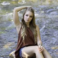 Country Girl Sitting on a Rock