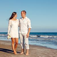 Couple in white clothes on the seaside